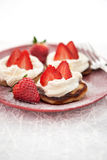 Pancakes with whipped cream and strawberry Stock Photo