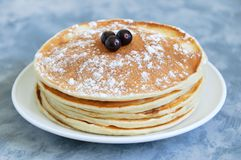 Pancakes on a white plate close-up royalty free stock images