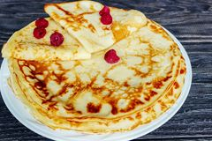Pancakes on a white plate with honey and a cup of milk. Tasty br. Eakfast Royalty Free Stock Photo