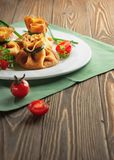 Pancakes with meat, tied with green onions royalty free stock images