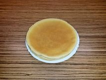 Pancakes on white porcelain plate, from above, burnt royalty free stock image