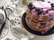 Pancakes on white table with blueberry royalty free stock photo