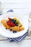 Pancakes with wild berries Stock Photo