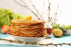 Pancakes and willow branches Stock Photos