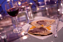 Pancakes and wine Stock Images