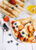 Pancakes with wipped cream and strawberries Stock Photography