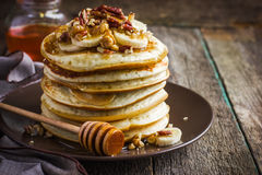 Free Pancakes With Banana, Nuts And Honey Stock Photography - 55199102
