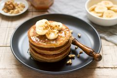 Free Pancakes With Banana, Nuts And Honey, Served With Tea. Rustic Style Royalty Free Stock Image - 135027606