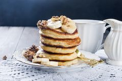 Free Pancakes With Banana, Nuts ,honey And Cup Coffee On Dark Background Stock Image - 107659291