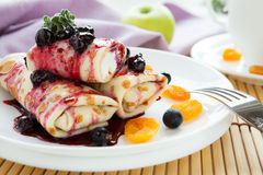 Pancakes With Cottage Cheese In The Middle And Berry Sauce Stock Photos