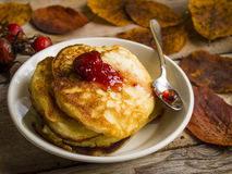 Pancakes on the wooden background. Pancakes and yellow leaves on the wooden background stock photos