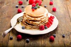 Pancakes on wooden table Stock Photo