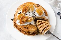 Pancakes with yogurt, caramelized banana and chocolate Royalty Free Stock Images