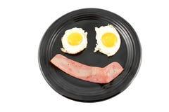 Pancetta affumicata e sorriso delle uova Immagine Stock Libera da Diritti