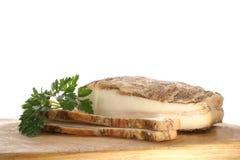 Pancetta affumicata grassa su un timberboard Fotografia Stock