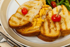 Pancetta Mac and Cheese Panini. Grilled Macaroni and Cheese Sandwich. Selective focus Royalty Free Stock Images