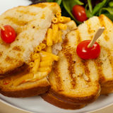 Pancetta Mac and Cheese Panini. Grilled Macaroni and Cheese Sandwich. Selective focus Royalty Free Stock Photo