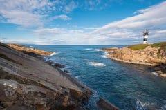 Pancha island lighthouse in Ribadeo coastline, Galicia, Spain.  royalty free stock photography