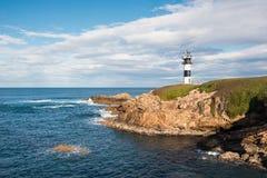 Pancha island lighthouse in Ribadeo coastline, Galicia, Spain.  royalty free stock photos