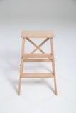 Panchetto di legno su un fondo bianco Fotografia Stock Libera da Diritti