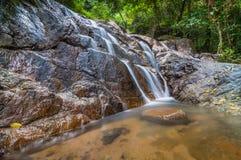 Panchur waterfall kenyir from left. This waterfall located near kenyir dam inside kenyir lake area Royalty Free Stock Photo