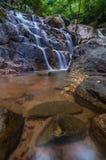 Panchur Waterfall in vertical view. This panchur waterfall is located at kenyir lake, terengganu malaysia Stock Photos