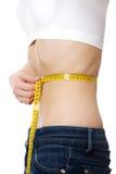 Pancia di bella giovane femmina con anorexia Immagini Stock Libere da Diritti