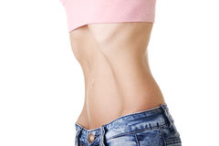 Pancia di giovane femmina con anorexia fotografie stock