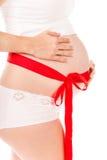 Pancia di gravidanza come regalo immagine stock