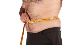 Pancia di misurazione dell'uomo di peso eccessivo Fotografie Stock