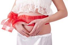 Pancia di una ragazza incinta Fotografia Stock