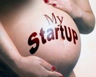 Pancia incinta, progetto dello start-up fotografia stock