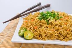 Pancit with chopsticks stock photos