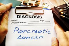 Pancreatic cancer diagnosis on a medical form. Pancreatic cancer diagnosis on a hospital table stock images