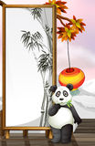 A panda with a bamboo-designed frame Royalty Free Stock Photos