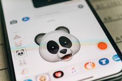 Panda bear 3d animoji emoji generated by Face ID facial  iphone. PARIS, FRANCE - NOV 9 2017: Panda bear 3d animoji emoji generated by Face ID facial recognition Royalty Free Stock Photography