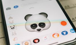 Panda bear 3d animoji emoji generated by Face ID facial  iphone. PARIS, FRANCE - NOV 9 2017: Panda bear 3d animoji emoji generated by Face ID facial recognition Stock Photos
