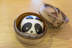 Panda Bun. Chinese sweet bun made like panda in the bamboo steamer stock photography