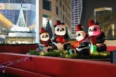 Panda con los sombreros de la Navidad Imágenes de archivo libres de regalías