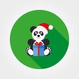 Panda dans un chapeau de Santa avec un cadeau Photos stock