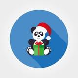 Panda dans un chapeau de Santa avec un cadeau Photo stock