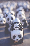 Panda dolls. Close up of Panda dolls made of paper display outdoor with selective focus and tint filtered Stock Images