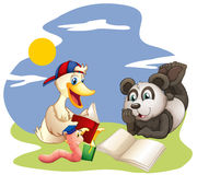 A panda, a duck and a worm reading Stock Photo