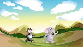 A panda and an elephant walking along the mountains Royalty Free Stock Images