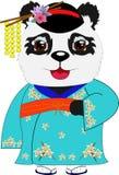 Panda en un kimono azul con los ornamentos Foto de archivo