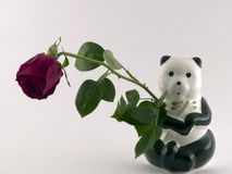 Panda holding a rose. Panda with a rose in its arm Stock Photo