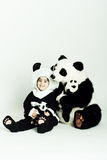 Panda love3. Child wearing a panda costume holding a little baby panda Stock Image