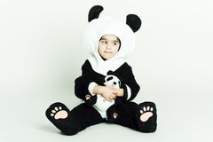 Panda love34. Child wearing a panda costume holding a little baby panda Royalty Free Stock Photos