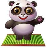 Panda på bambumatta Arkivbilder