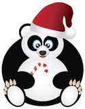 Panda Sitting with Santa Hat and Candy Cane Stock Images
